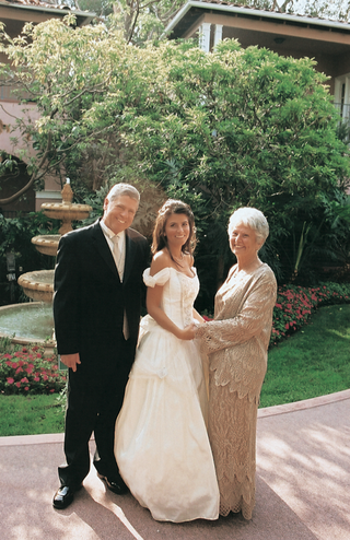 bride-wearing-off-the-shoulder-dress-with-parents