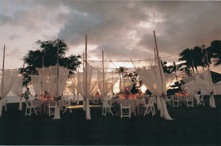 tables-chairs-and-drapery-on-green-lawn-overlooking-ocean