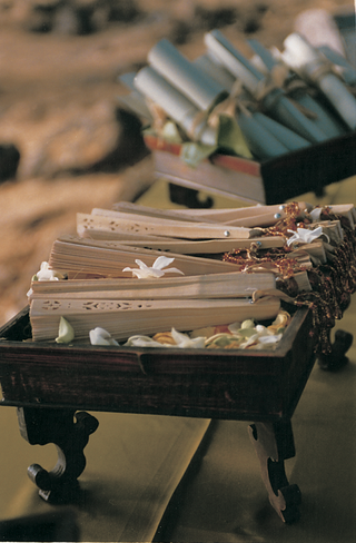 wedding-programs-and-paper-fans-displayed-in-wooden-boxes