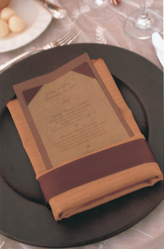 orange-napkin-holds-brown-menu-card