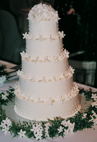 five-layer-cake-with-flowers-and-frosting-dots