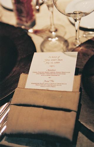 white-menu-stationery-in-gold-linen-napkin