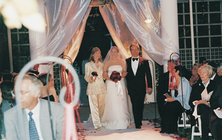bride-walks-into-ceremony-with-mother-and-father