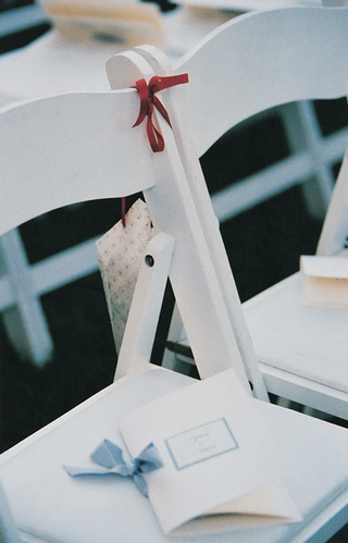 white-wedding-program-on-ceremony-chair