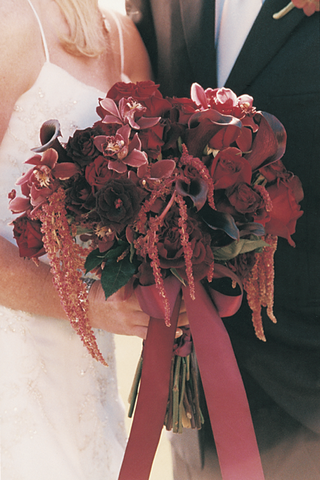 burgundy-flowers-tied-together-with-rouge-ribbon