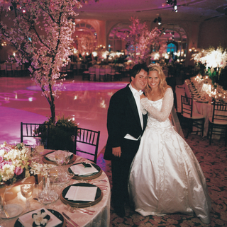 groom-in-long-tail-tux-and-bride-in-princess-ball-gown