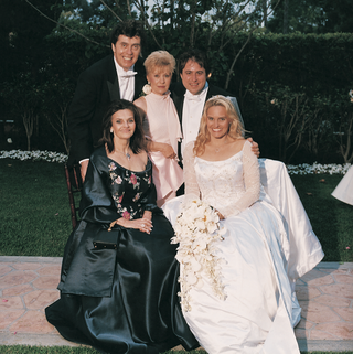 bride-sits-with-mother-and-grooms-family