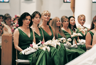 bridesmaids-in-v-neck-dresses-with-white-gloves