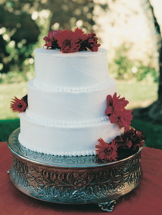 three-layer-cake-on-silver-platter-with-buttons