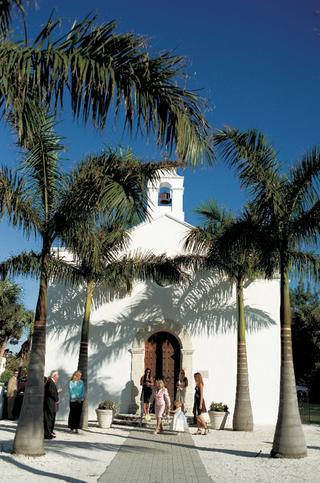 palm-trees-outside-white-church-on-beach