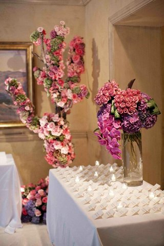 pink-and-purple-floral-arrangements-on-white-table