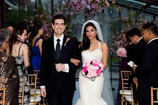 bride-and-groom-walk-up-the-aisle-arm-in-arm