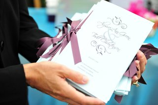 white-ceremony-booklets-with-purple-ribbons