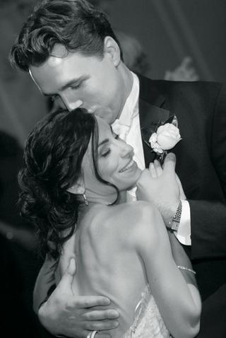 black-and-white-photo-of-newlyweds-embrace