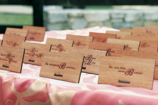 wood-place-cards-on-a-pink-and-white-print-tablecloth