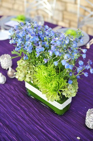 crystal-wrapped-rectangular-vase-with-blue-flowers