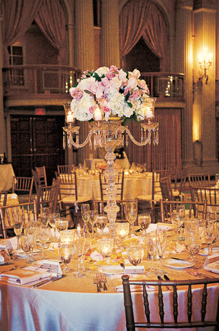 wedding-reception-centerpiece-of-crystal-candelabra-with-pink-and-white-flowers