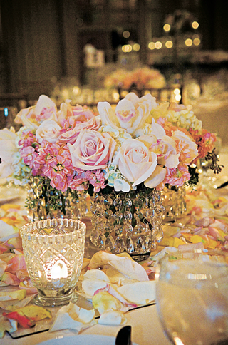 small-wedding-reception-centerpiece-of-roses-orchids-and-hydrangeas