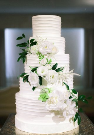 crisp-white-wedding-cake-with-fresh-flowers-down-the-tiers