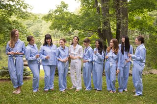 bride-in-white-pajama-set-bridesmaids-in-periwinkle-blue-pajama-set-in-forest