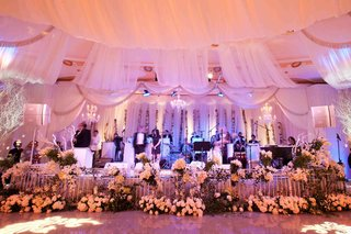 live-wedding-band-stage-with-fabric-and-flower-border