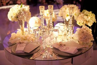 white-flowers-on-mirror-table-with-ivory-flowers
