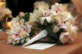 ivory-and-pink-orchids-wrapped-in-white-ribbon