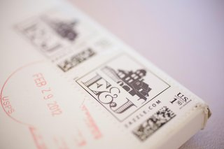 couples-initials-on-stamp-for-wedding-invite