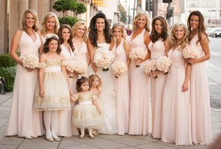 bride-with-flower-girls-and-bridesmaids-in-light-pink-gowns
