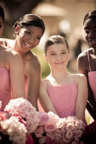 teenage-bridesmaids-in-pink-dresses-with-pink-bouquets