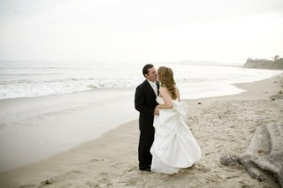 bride-and-groom-kiss-on-beach-in-santa-barbara