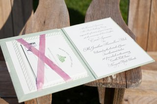 green-book-cover-with-calligraphy-invitation-and-cards