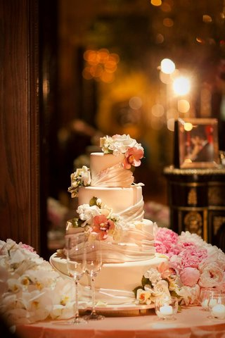 four-layer-ivory-cake-with-flowers-and-ribbons