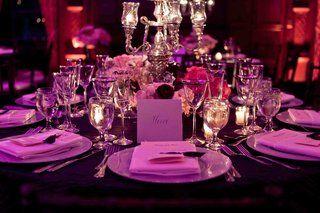 silver-centerpiece-with-purple-lighting-on-reception-table