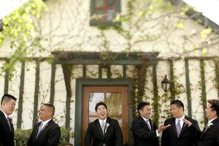 groom-with-groomsmen-in-front-of-vineyard-home