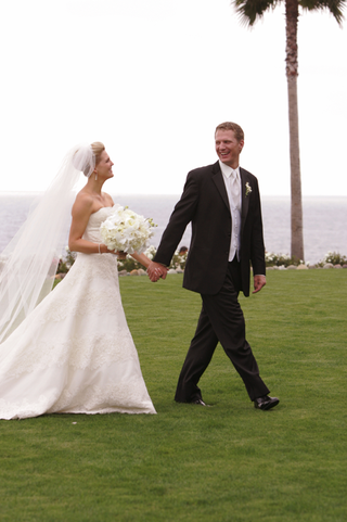 bride-and-groom-walk-on-grounds-of-montage-laguna-beach