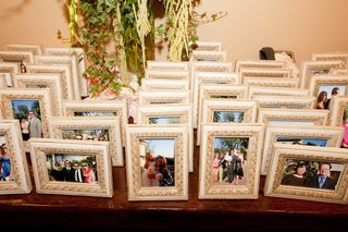 picture-frames-arranged-on-table-for-guests