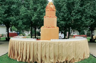 a-wedding-cake-made-of-fabric-decorates-the-cocktail-hour