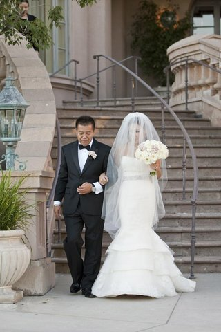 asian-dad-and-bride-walk-down-stairs-before-ceremony