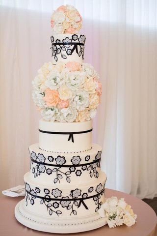 white-cake-with-sugar-flower-bouquet-and-black-floral-motif