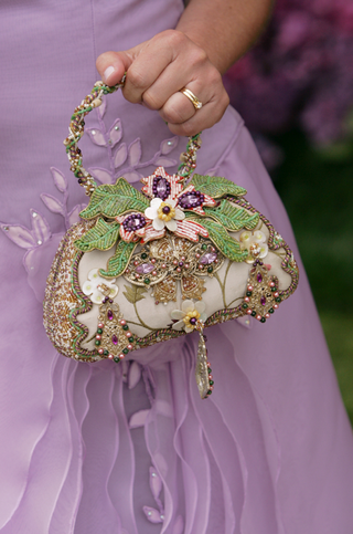 mother-of-the-bride-holding-jewel-flower-purse