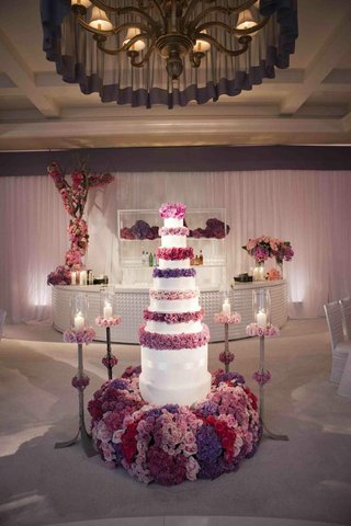 six-foot-tall-cake-with-purple-rose-layers