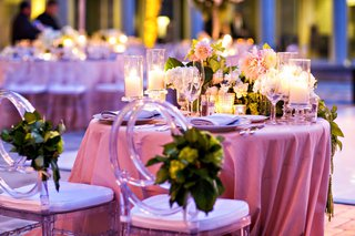 sweetheart-table-round-with-clear-back-chairs-lucite-and-candles-low-flower-arrangements-dahlias