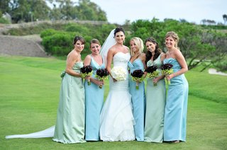 trumpet-mermaid-dress-and-bridesmaids-on-golf-course