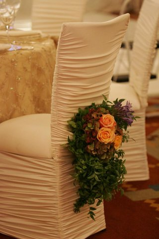 ruched-ivory-chair-covers-at-reception
