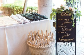 wedding-ceremony-outdoor-ideas-sunglasses-parasols-in-basket-and-other-favors