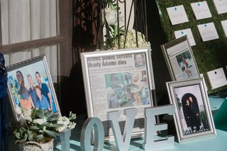 wedding-reception-table-with-family-photos-newspaper-articles-of-brady-adams-former-oregon-senate