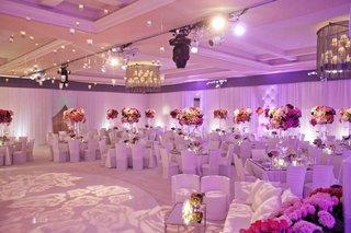 ballroom-illuminated-with-purple-lighting-and-roses