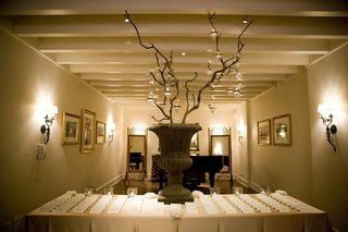 wedding-seating-cards-on-table-with-manzanita-branches