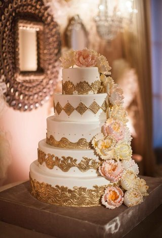 white-cake-with-gold-details-and-sugar-flower-peonies